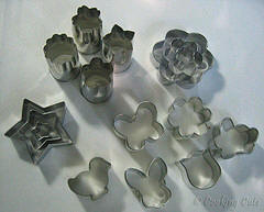 various mini-cookie cutters of different shapes and sizes